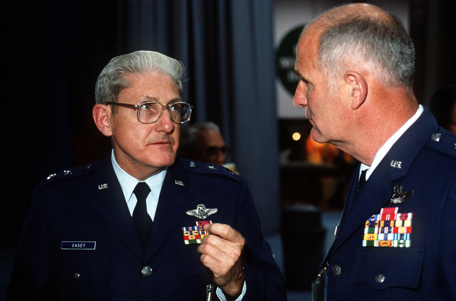 """MAJ. GEN. Aloysius G. Casey, commander, Ballistic Missile Office, talks with LT. GEN. Thomas McMullen, commander, Aeronautical Systems Division, during the Air Force Association's """"Gathering of Eagles,"""" a convention commemorating spectacular achievements in the free world's aerospace development"""