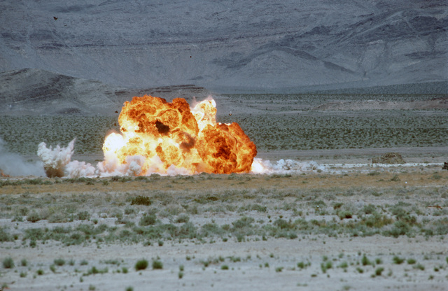 """Ordnance detonates on impact with target during a firepower demonstration conducted for the Air Force Association's Gathering of Eagles,""""a convention commemorating spectacular achievements in the free world's aerospace development"""