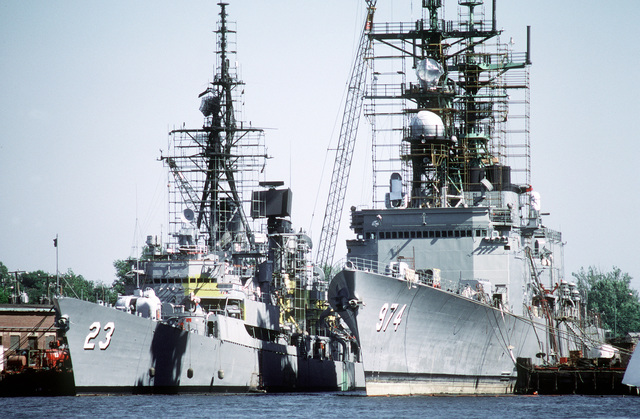 A port bow view of the guided missile destroyer USS RICHARD E. BYRD (DDG-23) and the destroyer USS COMTE DE GRASSE (DD-974) undergoing overhaul