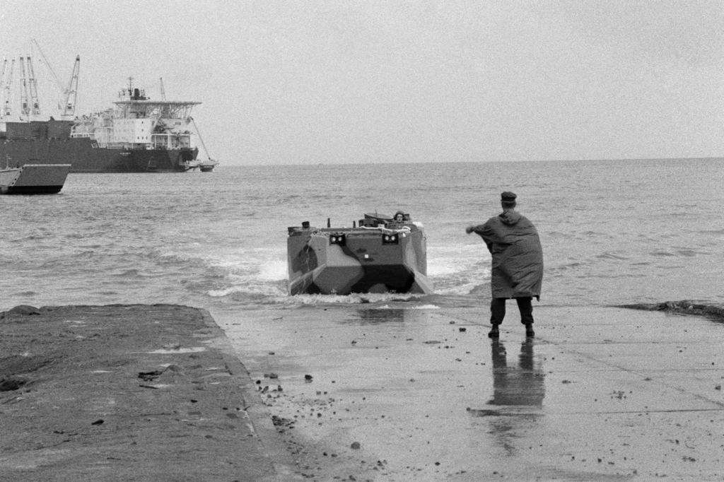 AAVP7 Amphibian Assault Vehicle comes ashore from the maritime prepositioning ship MV CPL. LOUIS J. HAUGE JR. (T-AK 3000) during Exercise FREEDOM BANNER'86