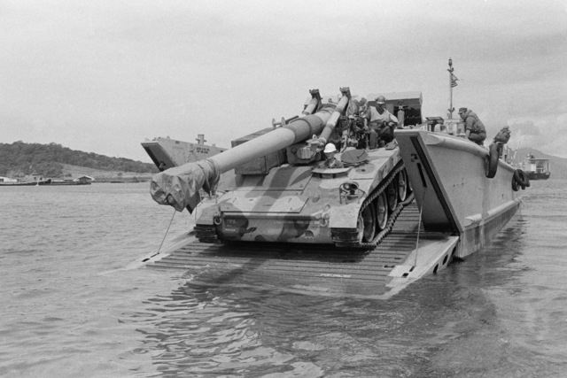 An M110 203 mm Self-propelled Howitzer is offloaded from a landing craft during Exercise FREEDOM BANNER'86