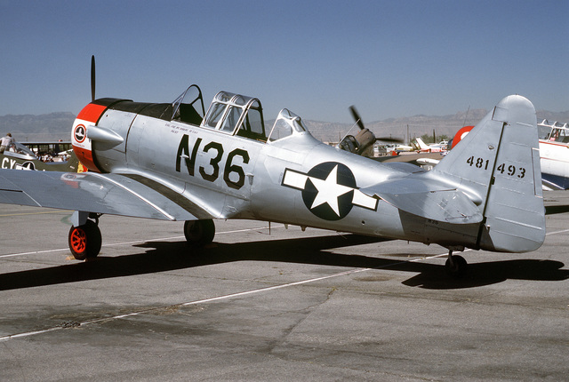 """Left side view of a Douglas built SBD """"Dauntless"""" aircraft on the flight line at McCarren Airport, Las Vegas, Nevada during the USAF Gathering of Eagles convention. Exact Date Shot Unknown"""