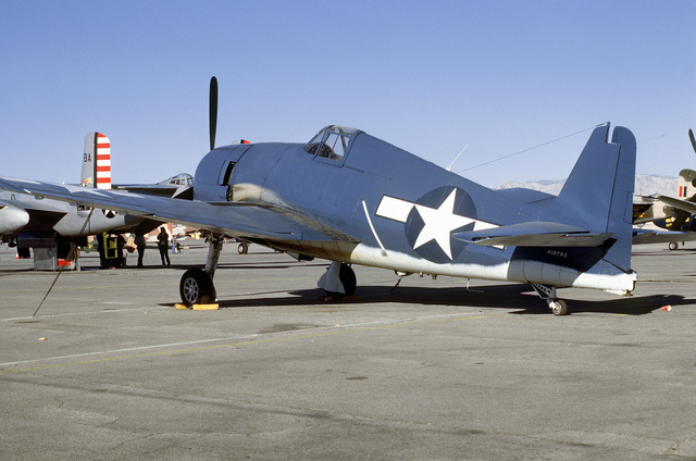 "Left side view of a Grumman built F6F ""Hellcat"" fighter aircraft on the flight line at McCarren Airport, Las Vegas, Nevada during the USAF Gathering of Eagles convention. Exact Date Shot Unknown"