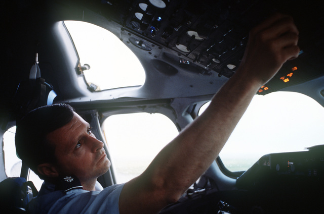 Lieutenant Colonel (LTC) Leonard Trovero, 55th Aeromedical Airlift Squadron, goes through a preflight check list before taking his C-9A Nightingale aircraft onto the runway