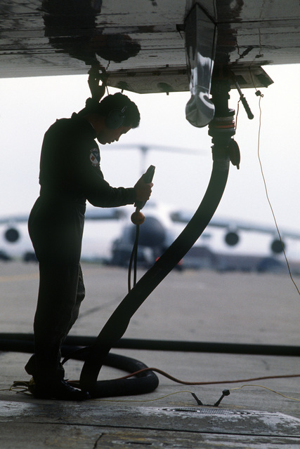 Senior AIRMAN (SRA) Paul DeChiara, flight mechanic, 55th Aeromedical Airlift Squadron, refuels a C-9A Nightingale aircraft prior to its departure to Izmir, Turkey