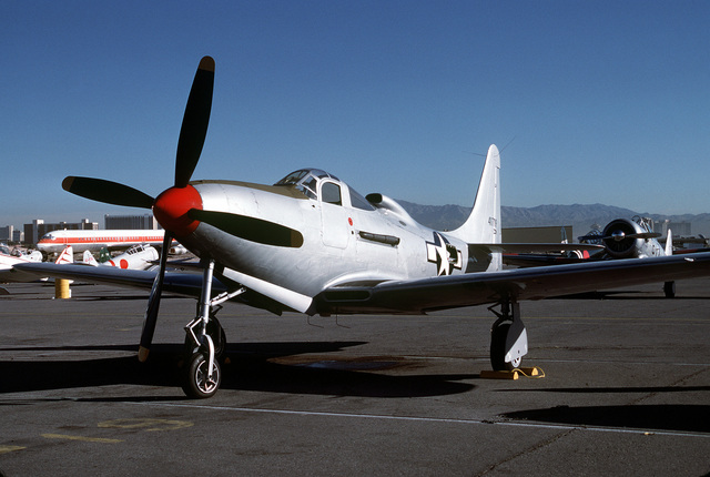 """Three quarter front view of a Bell built P-63 """"Kingcobra"""" pursuit aircraft on the flight line at McCarren Airport, Las Vegas, Nevada during the USAF Gathering of Eagles convention. Exact Date Shot Unknown"""