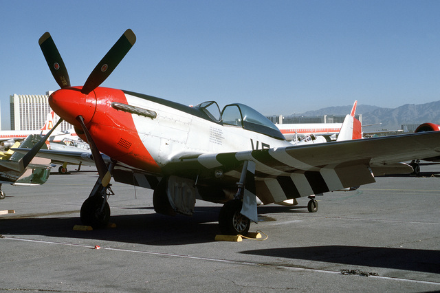 """Three quarter front view of a North American built P-51 """"Mustang"""" pursuit aircraft on the flight line at McCarren Airport, Las Vegas, Nevada during the USAF Gathering of Eagles convention. Exact Date Shot Unknown"""