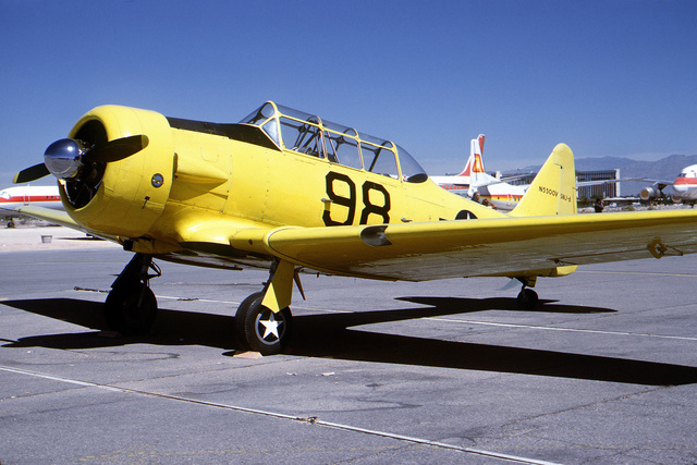 """Three quarter front view of a North American built SNJ """"Texan"""" aircraft on the flight line at McCarren Airport, Las Vegas, Nevada during the USAF Gathering of Eagles convention. Exact Date Shot Unknown"""