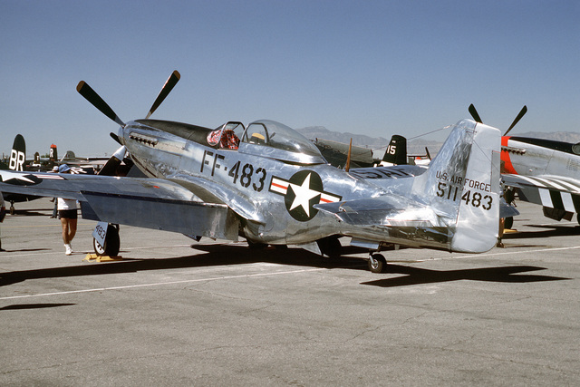 """Three quarter rear view of a North American built P-51 """"Mustang"""" pursuit aircraft on the flight line at McCarren Airport, Las Vegas, Nevada during the USAF Gathering of Eagles convention. Exact Date Shot Unknown"""