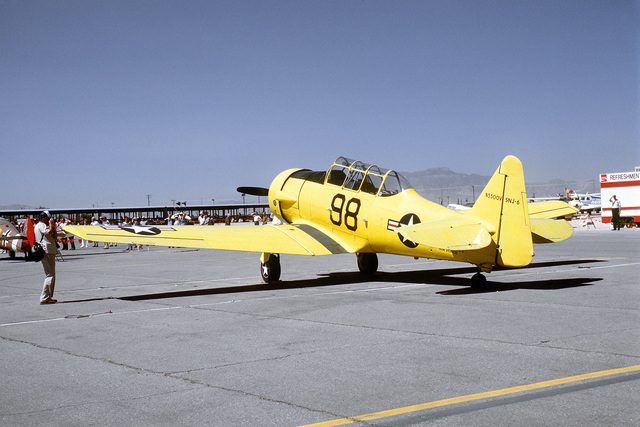 """Three quarter rear view of a North American built SNJ """"Texan"""" aircraft on the flight line at McCarren Airport, Las Vegas, Nevada during the USAF Gathering of Eagles convention. Exact Date Shot Unknown"""