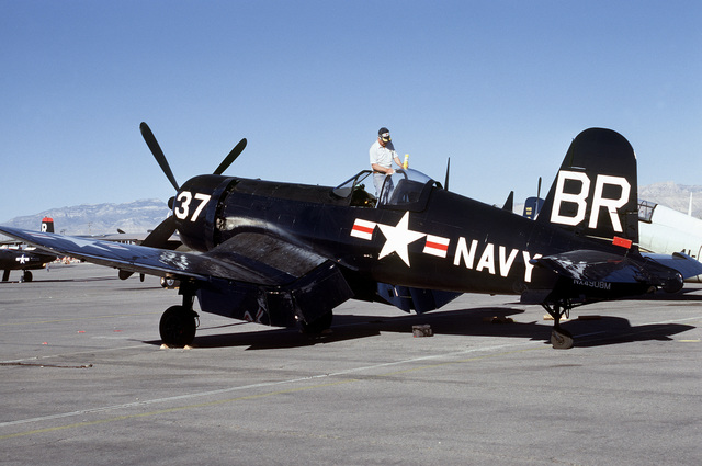 "Three quarter rear view of a Vought built F4U ""Corsair"" fighter aircraft on the flight line at McCarren Airport, Las Vegas, Nevada during the USAF Gathering of Eagles convention. Exact Date Shot Unknown"