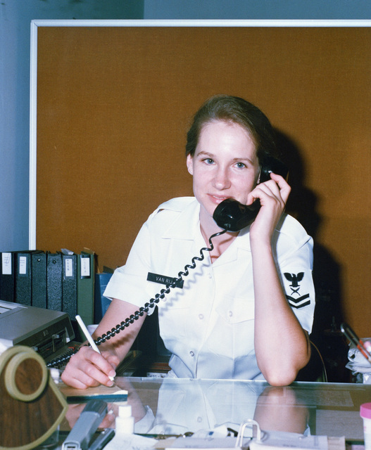 Yeoman 2nd Class L. Van Rija, administrative assistant, Military Sealift Command Headquarters, answers telephone inquiries during Rainbow Reach, an ocean transportation mobilization exercise