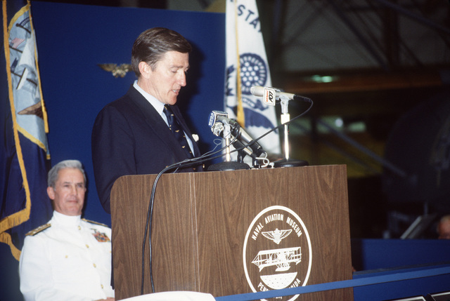 Secretary of the Navy John F. Lehman speaks during an induction ceremony for members of the Hall of Honor at the Naval Aviation Museum. The ceremony is taking place on the 75th anniversary of naval aviation