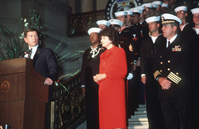 Governor John Ashcroft of Missouri speaks during a post-recommissioning ceremony at City Hall. On the right is Mayor Dianne Feinstein and Captain (CAPT) Albert L. Kaiss, commanding officer of the battleship USS MISSOURI (BB 63). (SUBSTANDARD)
