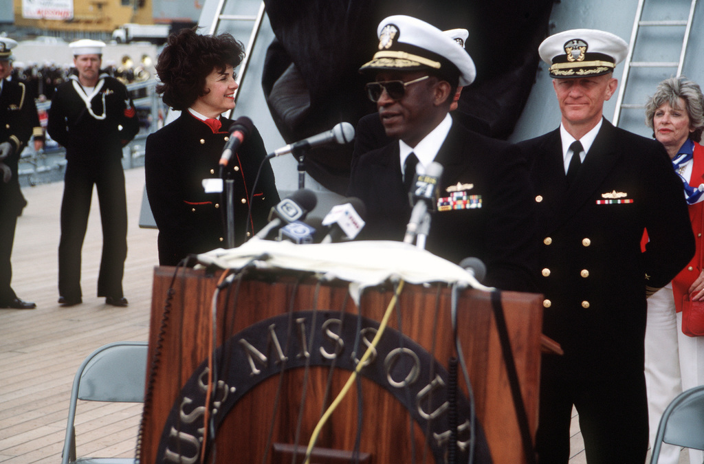 Rear Admiral (RDML) (lower half) Robert L. Toney, commander, Naval Base, San Francisco, speaks with reporters during a press conference aboard the battleship USS MISSOURI (BB 63). The ship has just arrived in San Francisco to be recommissioned