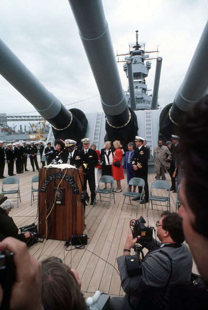 Rear Admiral (RDML) (lower half) Robert Toney, commander, Naval Base, San Francisco, speaks with reporters during a press conference aboard the battleship USS MISSOURI (BB 63). The ship has just arrived in San Francisco to be recommissioned