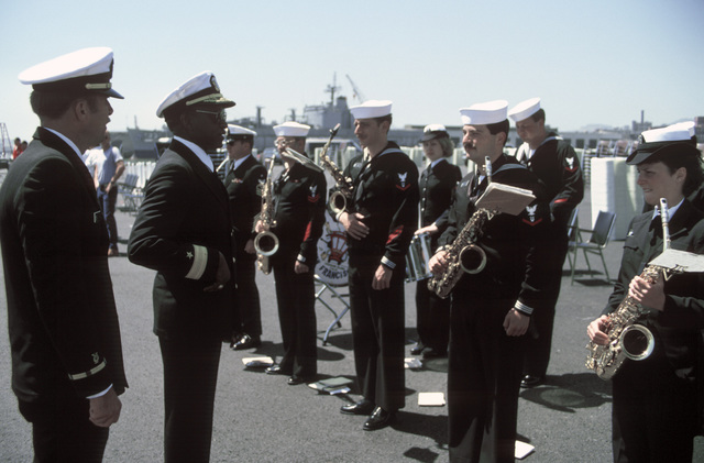 Rear Admiral (RDML) (lower half) Robert Toney, commander, Naval Base, San Francisco, thanks the San Francisco Navy Band for their participation in the recommissioning of the battleship USS MISSOURI (BB 63)