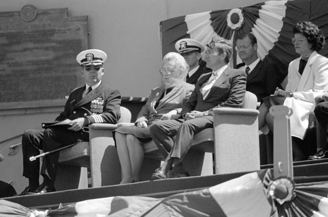 Seated on the speakers platform during the recommissioning of the battleship USS MISSOURI (BB 63) are Captain (CAPT) Albert L. Kaiss, commanding officer; Margaret Truman Daniels, sponsor; and John F. Lehman Jr., secretary of the Navy