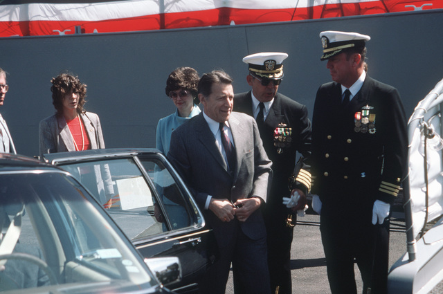 Secretary of Defense Caspar W. Weinberger is welcomed to the recommissioning of the battleship USS MISSOURI (BB 63) by Captain (CAPT) Albert L. Kaiss, commanding officer