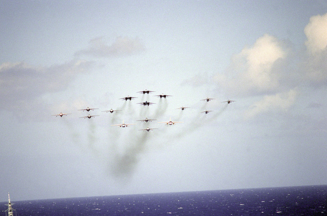 Aircraft of the nuclear-powered aircraft carrier USS CARL VINSONs (CVN-70) air wing fly in a diamond formation during an aerial demonstration