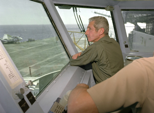 GEN. Robert W. Bazley, commander in chief, Pacific Air Forces, observes flight deck operations from the bridge of the nuclear-powered aircraft carrier USS CARL VINSON (CVN-70)