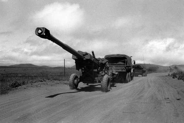 An M-198 155 howitzer of Battery B, 1ST Battalion, 8th Field Artillery Regiment, is towed by a truck through the Pohakuloa Training Area during exercise Opportune Journey 2-86