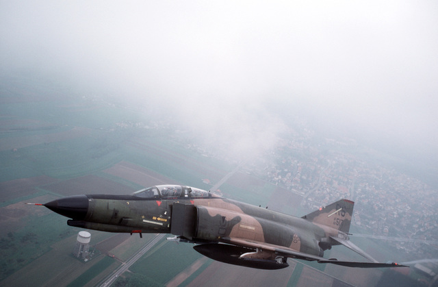 An air to air front view of a 526th Tactical Fighter Squadron F-4E Phantom II aircraft shortly after taking off from Ramstein Air Base on one of its last missions. The F-4E aircraft of the 526th TFS are being replaced by new F-16C Fighting Falcon aircraft
