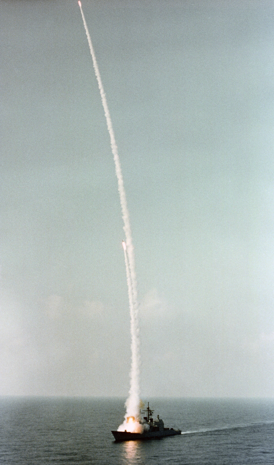 The guided missile cruiser BUNKER HILL (CG 52) test fires two RIM-66C SM-2 missiles from the forward Mark 41 Vertical Launching System (VLS) during sea trails
