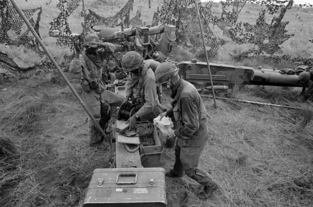 A fire team from the 1ST Battalion, 8th Field Artillery Regiment, sets up their M198 155 mm Howitzer during Exercise OPPORTUNE JOURNEY 2-86