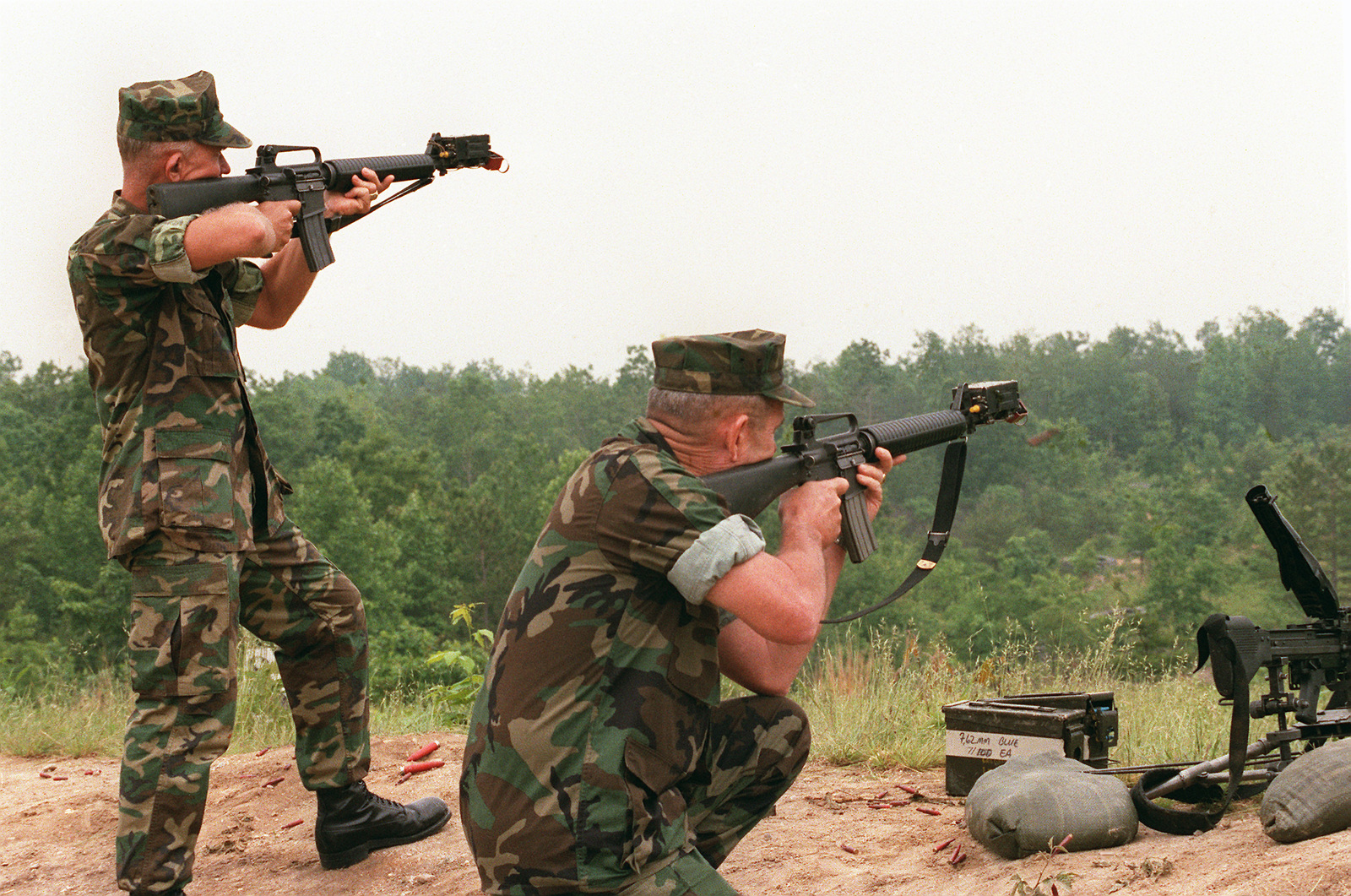 Marines fire M16A2 rifles equipped with the multiple integrated