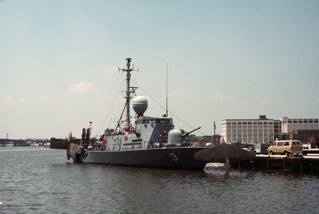 A starboard bow view of the patrol missile hydrofoil USS TAURUS (PHM 3) moored at pier No. 2 at the Washington Navy Yard. The ship's foils are retracted