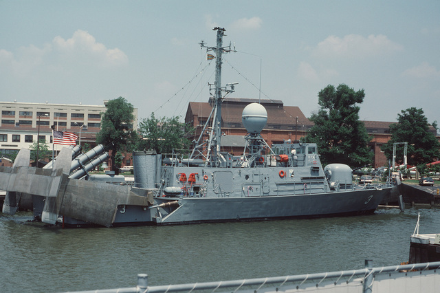 A starboard quarter view of the patrol missile hydrofoil USS TAURUS (PHM 3) moored at pier No. 2 at the Washington Navy Yard. The ship's foils are retracted