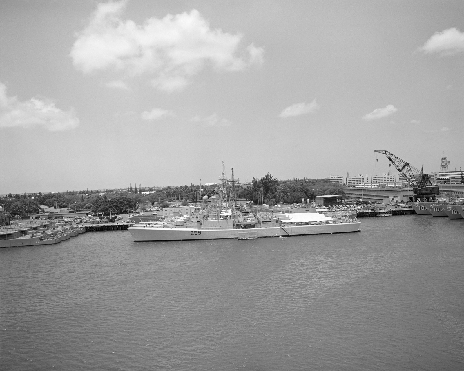 A port beam view of Canadian frigates moored to piers during Exercise RIMPAC '86