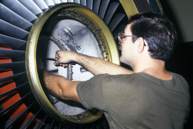 A technician from the 354th Component Repair Squadron repairs the power take-off assembly inside the engine of an A-10 Thunderbolt II aircraft