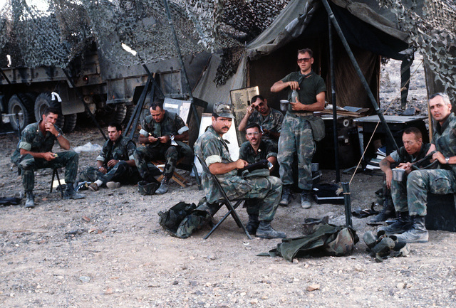 Officers of Headquarters Btry., 3rd Bn., 14th Artillery Regt., take a meal break at the end of the second day of a combined arms exercise