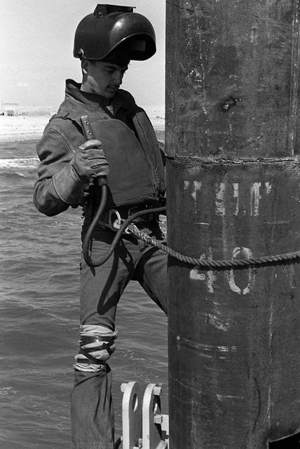 Steelworker Constructionman Grant Ramey, Amphibious Construction Battalion 2, welds a pier piling during Exercise ELCAS (Elevated Causeway), a training exercise in which Seabees learn pier-construction techniques