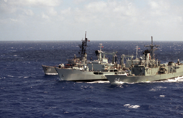 The Canadian replenishment oiler HMCS PROVIDER (AOR 508), the Australian guided missile frigate HMAS DARWIN (FFG 04) and the guided missile destroyer USS BERKELEY (DDG 15) participate in an underway replenishment during Exercise RIMPAC'86