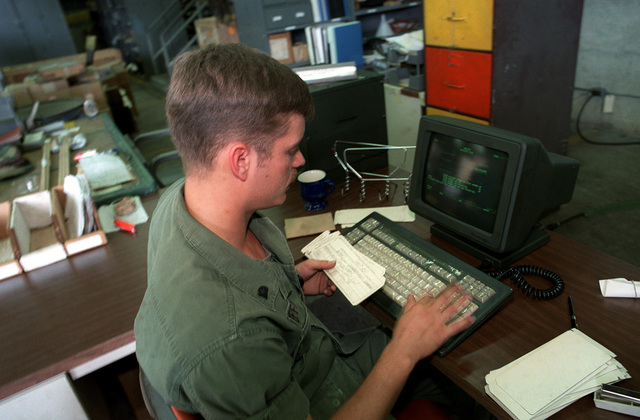 SPEC. 4 Charles Effinger works at a Tactical Army Combat Support Computer System (TACCS) terminal. The TACCS is used in the supply office and warehouse of the 210th Aviation Battalion, 193rd Infantry Brigade