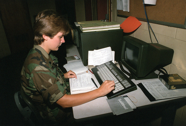 SPEC. 4 Sharon Reilly works at a Tactical Army Combat Support Computer System (TACCS) terminal. The TACCS is used in the supply office and warehouse of the 210th Aviation Battalion, 193rd Infantry Brigade (Separate)