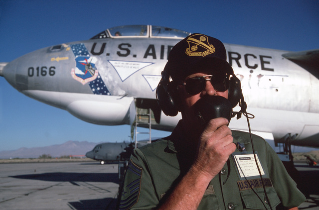 CHIEF Mater Sergeant (CMSGT) Richard Lindsey takes the new crew of a restored B-47E Stratojet aircraft through a final preflight check list. The aircraft is one of the last flyable B-47s in the world and will be flown to Merced, California, where it will be displayed with other preserved aircraft in the Castle AFB Museum, China Lake Weapons Center