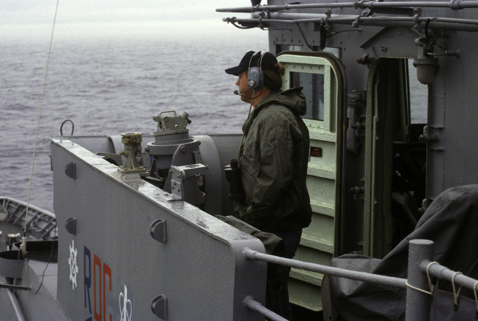 A crewman stands watch on the bridge of the guided missile cruiser USS YORKTOWN (CG 48)