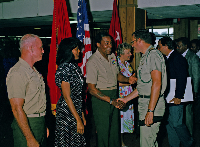 Lieutenant General (LGEN) Frank E. Peterson Jr., incoming commanding general, Marine Corps Development and Educational Center, and his wife greet guests attending the change of command ceremony