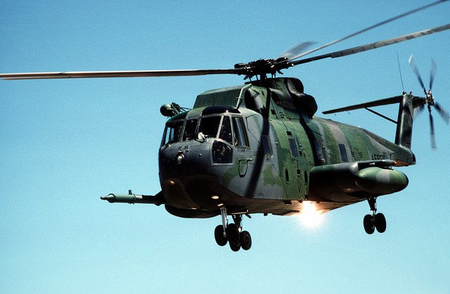 A left front view of an HH-3E Jolly Green Giant helicopter in-flight during Exercise Patriot Coyote