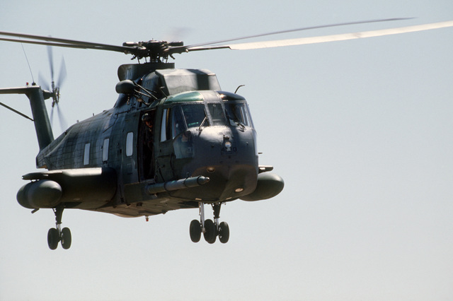 A right front view of an HH-3E Jolly Green Giant helicopter in flight during Exercise PATRIOT COYOTE