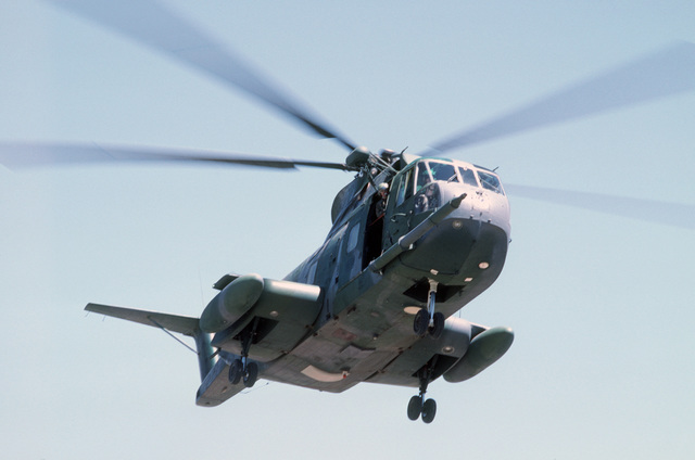 A right underside view of an HH-3E Jolly Green Giant helicopter in flight during Exercise PATRIOT COYOTE