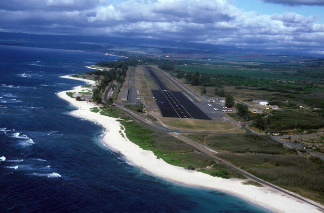 An aerial view, looking east, of Dillingham Air Force Base. Located on the north shore of the island, the field is used for touch and go landings, the Air Force parachute team and the glider club
