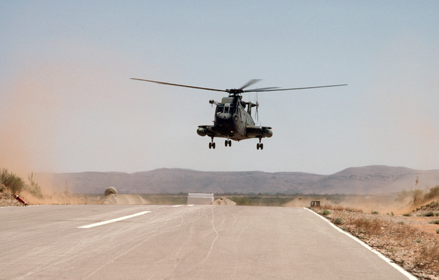 An HH-3E Jolly Green Giant helicopter takes off during Exercise PATRIOT COYOTE