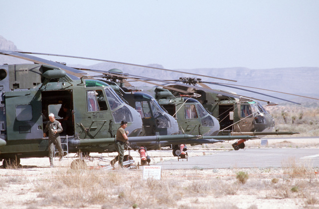 Maintenance crews from the 301st and 305th Aerospace Rescue and Recovery Squadrons check HH-3E Jolly Green Giant helicopters in preparation for Exercise PATRIOT COYOTE