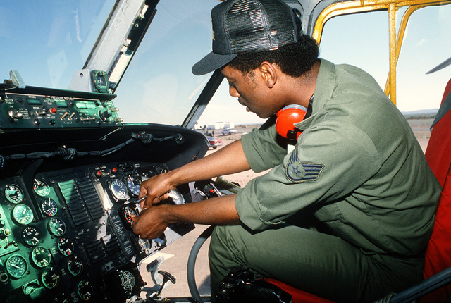 Staff Sgt. Timothy C. Jackson, turboprop mechanic, 301st Aerospace Rescue and Recovery Squadron, works on a helicopter control panel during Exercise Patriot Coyote