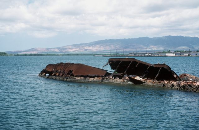 A view of the wreck of the former battleship/target ship UTAH (BB-31/AG-16), which was sunk at her moorings on the west side of the Ford Island on December 7, 1941, during the Japanese attack on Pearl Harbor